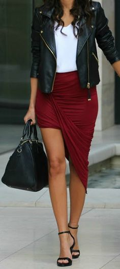 Leather jacket + burgundy skirt.