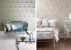 blue velvet settee with mirrored table. vintage metallic wallpaper