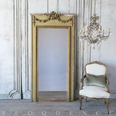 Eloquence® Antique French Mirror: 1880 This antique Louis XVI style trumeau mirror is finished in a mossy green, and dark gilt. It features lovely, large gilt carvings in a swag ribbon motif across the top and detailed carvings around the mirror's edge.