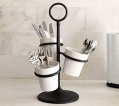 Kitchen Decor Pottery Barn Rhodes Utensil Caddy - Keep flatware at hand with this space-saving caddy. Supported by a handsome cast-iron stand, three angled and staggered stoneware pots keep utensils from overlapping. Utensil Caddy, Pottery Barn, Flatware Caddy, Kitchen Gadgets, Ceramic Kitchen, Kitchen Storage Organization, Kitchen Organization, Kitchen Accessories, Countryside Kitchen