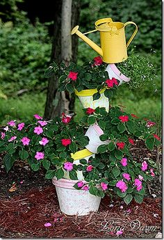 So cute!  Love the watering can as a finishing touch... but I think if I had pinkish flowers I'd paint it to match them.
