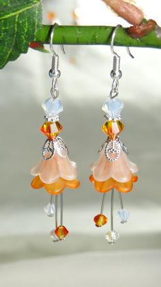 Vintage Lucite Flower Dangle Earrings-Orange & White. $10.00, via Etsy.