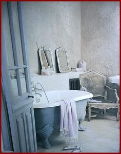 French country bath with claw foot tub