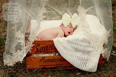 Baby girl newborn session with her Mama's wedding veil! From La Dolce Vita Photography Studios