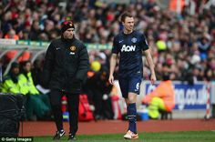Woe: Jonny Evans was forced off after just 11 minutes as Manchester United are forced to re-shape at Stoke.