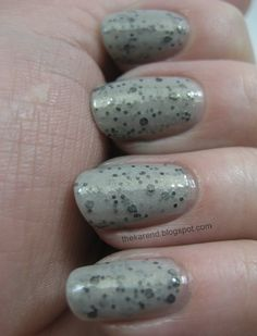 Afternoon Thunderstorms has black glitter and gold shimmer in a grey base.
