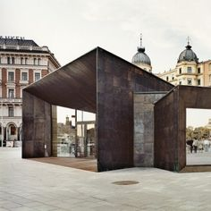 Brass squares give patchwork facade to  Stockholm ferry terminal by Marge Arkitekter