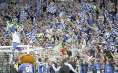 Like watching Brazil: Luiz and the travelling Chelsea fans joined in a spot of flag waving  Picture: AP