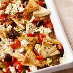 Crumbled feta cheese and sliced Kalamata olives add tanginess to this comforting casserole, while chicken, pita bread, zucchini, and roma tomatoes make it a satisfying one-dish meal: http://www.bhg.com/recipes/chicken/casseroles/crowd-pleasing-chicken-casseroles/?socsrc=bhgpin022014greekchickenandpitacasserole&page=13