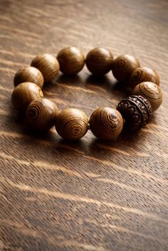 Large brown wood bead bracelet with hand carved mantra sandalwood focal bead by Pillow Book Jewelry Book Jewelry, Wood Bracelet, Spiritual Jewelry, Yoga Fashion, Prayer Beads, Brown Wood, Mantra, Diy Gifts, Hand Carved