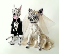Day of the dead doggie bride and groom made from polymer clay.