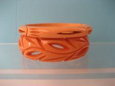 2 1930's Wide Carved Pierced butterscotch bracelets