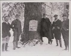 Prince Albert I of Monaco (left of tree, leaning on stump) and four members of hunting party, winter scene, 1913. Buffalo Bill Historical Center, Cody, Wyoming, USA. Original Buffalo Bill Museum Collection.