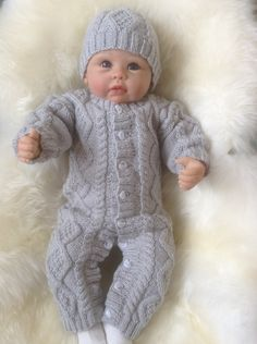 A personal favourite from my Etsy shop https://www.etsy.com/uk/listing/246901640/irish-knit-snowsuit-in-silver-grey-with