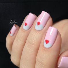 Cute heart accent nail art on pale pink & blue