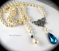 Hand knotted Pearl and Bermuda Blue Swarovski Crystal necklace. Perfect for formal events or weddings!