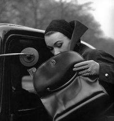 Sophie Litvak with handbag from Jacques Fath, photo by Georges Dambier, Paris, ELLE, January 12, 1953