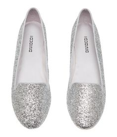 Silver-colored. Loafer-style flats with satin lining, satin insoles, and rubber soles.