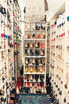 The ultimate in shoe heaven—centered with a glam chandelier. Courtesy Pinterest  - HarpersBAZAAR.com