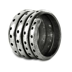 sarasas-stacked-ring A simple but pleasing creation, this Sarasas silver ring features a four-row band, accentuated with tiny circles simply carved out, all around.  The oxidized finish stamps the ring with rustic Indian charm.  Succinctly beautiful, this lovingly handcrafted piece is yours for the taking.