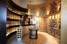 display of speciality bottles, note examples of  indirect lighting