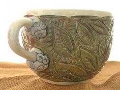 carved coffee mug . . . functional handmade pottery . . . so adorable . . . no, I don't have one yet . . . but it's on the list . . . :-)