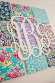 DIY Fabric Canvas and Monogram Wall Art - adorable look in a nursery or kids room!