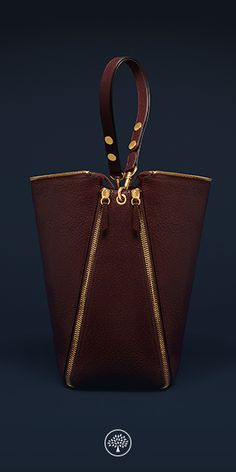 Shop the Camden bag in Oxblood Textured Goat leather, new for Autumn Winter 2016, the Camden's slouchy hobo style shoulder bag and statement zips were inspired by British punk rock culture. The zips travel down the sides and to the base of the bag where they fix together.