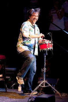 I love how happy and free he looks. I want to look and feel like that. Javier Bardem playing the bongos during the Asier Etxeandia Concert at Price Circus Theatre in Madrid.