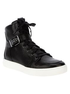 Black leather hi-top sneaker from Pierre Balmain featuring a round toe, a top lace up fastening, a silver-tone buckle fastening strap at the ankle, a padded panel at the opening and a contrasting white rubber sole.