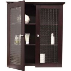 The Windham Espresso wall cabinet with glass doors will add space and functionality to any bathroom. It features a lovely espresso finish which blends well with many bathroom color schemes. It also features two tempered-glass doors and adjustable shelves.