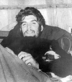 Che Guevara with a puppy. Che Guevara with a puppy.