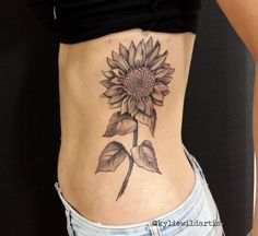Black and Grey Sunflower on Ribs Tattoo by Kylie H Wild Artist