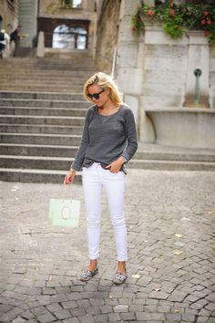 White pants, grey top, flats