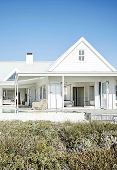 After scouting the ultimate location for their south african family home, a couple built it in a relaxed contemporary style. South African Homes, African House, Contemporary Beach House, Contemporary Style, Future House, My House, Dream Beach Houses, Timber House, Beach Shack
