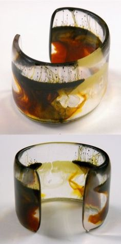 Fake horn color style in this semi-translucent resin bangle.