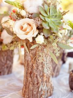 15 Rustic Wedding Centerpieces Photo by Half Orange Photography Mason jars and tree stumps???