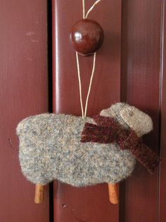 DIY felt sheep, that scarf needs a tiny jingle bell.and the legs can be made from cinnamon sticks