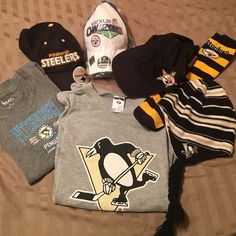 Pittsburgh sports lot! Hats, Ts, socks Pittsburgh sports lot! Hats, Ts, socks. 3 steelers hats, 1 steelers tube socks. 2 Pens shirts (1 ladies small/1 large regular T) pens beanie hat. Some new, some pre-loved. All clean and ready to wear to cheer the black and gold!!! Reasonable offers accepted. Pittsburgh Accessories