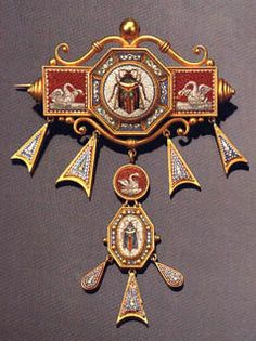 Brooch in the Archeological Style with a long pendant and inlayed Roman mosaics that represent scarabs and swans. It dates from year 1850.