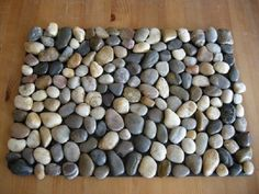 35 Awesome DIY Rugs You Could Be Making Right Now - How to make a #DIY DIY Pebble Bath Mat #homedecor