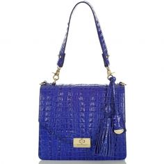 """Reminds me of a leather shop in Italy where their """"specialty"""" bag was one they had made for Grace Kelly. From what I remember, this style is an updated version of her famous bag."""