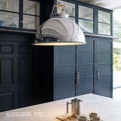 Original BTC's bold Titan Pendant reflects this light and airy interior using a polished aluminium shade. Taking inspiration from an original 1940s design, it is the perfect centrepiece for any Kitchen.