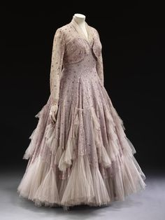 Evening ensemble, by Norman Hartnell. Tulle with vermicular embroidery and sequins lined with rayon taffeta, moiré. England, 1948.