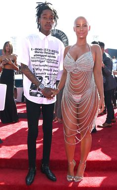 """Amber Rose & Wiz Khalifa from 2014 MTV Video Music Awards Red Carpet Arrivals  Wiz Khalifa posed with Amber Rose, but Amber stole all the attention in her body-baring chain ensemble that calls to mind Rose McGowan's 1998 """"dress."""""""