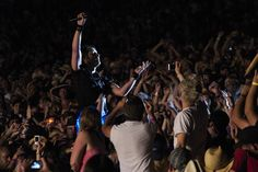 This was taken at Dauphin's Countryfest in 2010 (Manitoba, Canada). At one stage, Keith Urban disappeared offstage, re-emerging moments later in a sea of fans with his LED guitar. Though the image is crude, I think his mastery as a performer is captured in the adoration of the crowd.