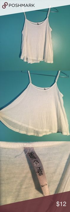 Flowy White Crop Tank - Adjustable Straps White Flowy tank. Adjustable straps. Soft & light. Small, very light blue stain on back. Looks great with high waisted shorts Love & Hips Tops Tank Tops