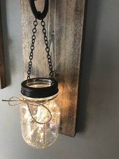 Hanging mason jar wall sconce set of 2 mason jar sconce with image 1 Mason Jar Wall Sconce, Hanging Mason Jars, Mason Jar Lighting, Mason Jar Lamp, Pot Mason, Quart Size Mason Jars, Rustic Wall Sconces, Rustic Walls, Colored Mason Jars