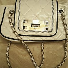 Cute small white purse This is a small white purse very simple but cute. Not something I use often; very few times. Good condition. Discounted bundles 30% off 2+ items I do take reasonable offers ?? Bags Shoulder Bags