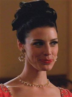 Season 5, Codfish Ball Episode...All the ladies are wearing drippy earrings to this formal event.  Megan's faux pearl chandeliers are most likely unsigned beauties, but designer Miriam Haskell was famous for her impressive faux pearl chandelier earrings, particularly made with baroque faux pearls, crystals and rhinestones.